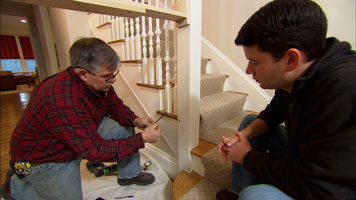 two people repairing a loose stair rail