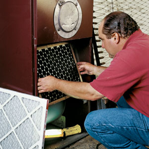 Richard Trethewey installs a media filter in a forced-air furnace