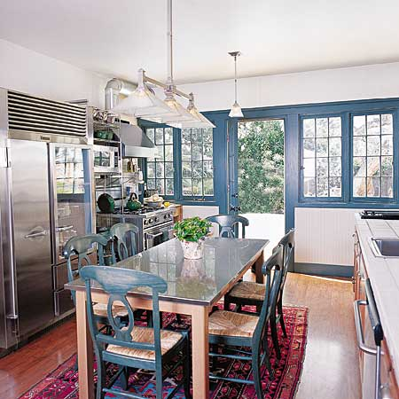 kitchen with centrally located table for eating and prep