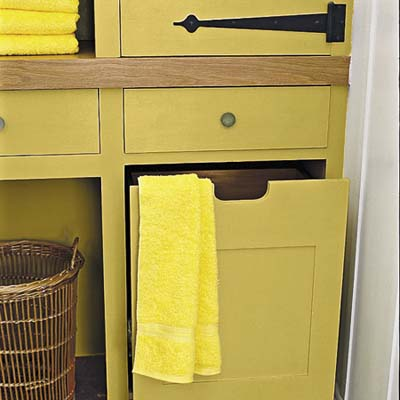 built-in storage unit is fitted with pull-out bins, cabinets and drawers