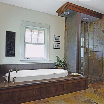 master bathroom has Neptune soaking tub and shower with multicolor slate tile
