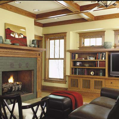 family room has coffered ceiling, fireplace, and handmade tiles with motifs