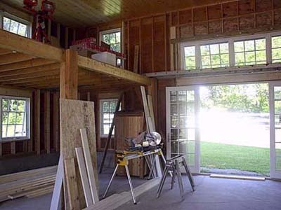 The interior of the old horse barn during its transformation.