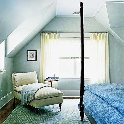 master bedroom with window dormers and a vaulted ceiling in Sag Harbor home