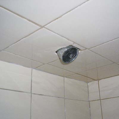 tiled-over shower head