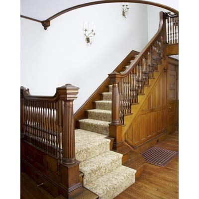 staircase with wood paneling