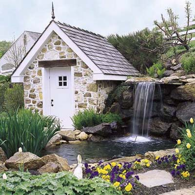 pond with waterfall and cute stone storage house