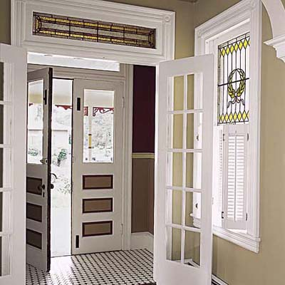 Queen Anne entry doors, stained-glass window, and new tile floor