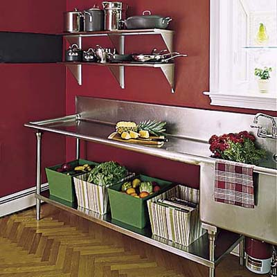 salvaged 10-foot-long stainless-steel pot-washing sink with under-counter storage and parquet floor in renovated Queen Anne's kitchen