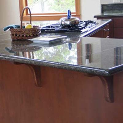 close-up view of a countertop constructed with Benissimo granite tiles