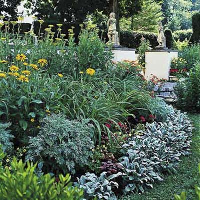 make layered plant beds by placing plants according to height, with the tallest in back, medium-height plants in the middle, and the shortest ones in front