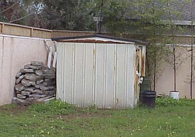 Damaged shed before demolition