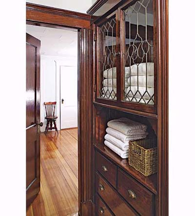 china cabinet turned linen closet