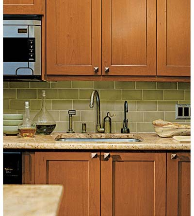 Rohl faucet and Rockler cabinet knobs in Arts and Crafts kitchen