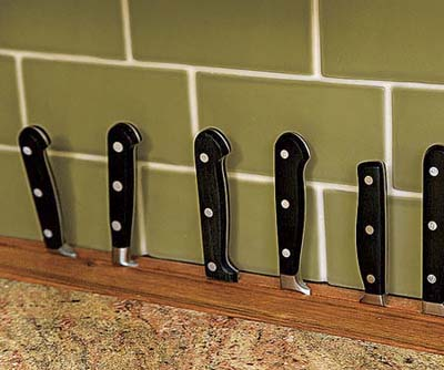 a built-in knife block uses dead space behind base cabinets