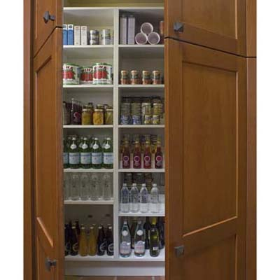Pantry with custom shelves in Arts and Crafts kitchen