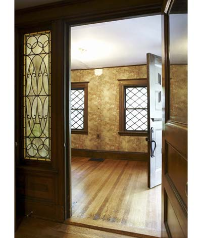 entryway with solid door and stained-glass windows