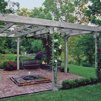 pergola with climbing perennial vines surround a brick patio with benches and fountain, this old house pinterest profile top pins of 2013