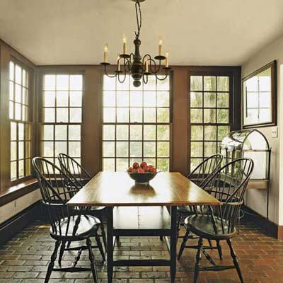 breakfast room with double-hung windows and brick floor in Ravenroyd