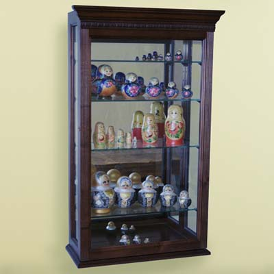 display case, wood-framed glass case, Russian dolls