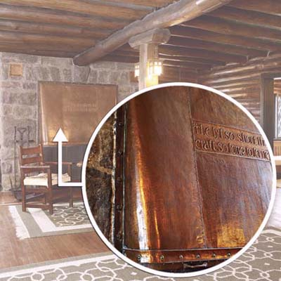 hand-hammered copper hood with Chaucer quote on Craftsman fireplace
