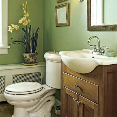 minimum elements for a half-bath with wood vanity and radiator cover