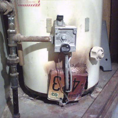 old license plate for car attached to water heater