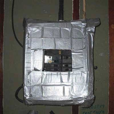 a duct tape front cover of the main electric panel at an electricians home