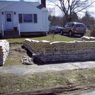 cement bags used as front yard retaining wall