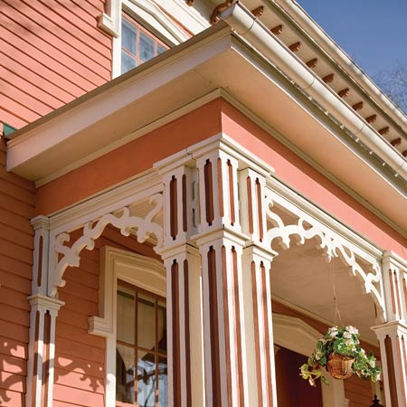 Italianate porch, columns, windows, and brackets after remodel