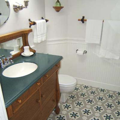 carriage house bath after renovation with refurbished wood vanity and wood fixtures