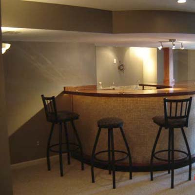 basement family room interior with wet bar