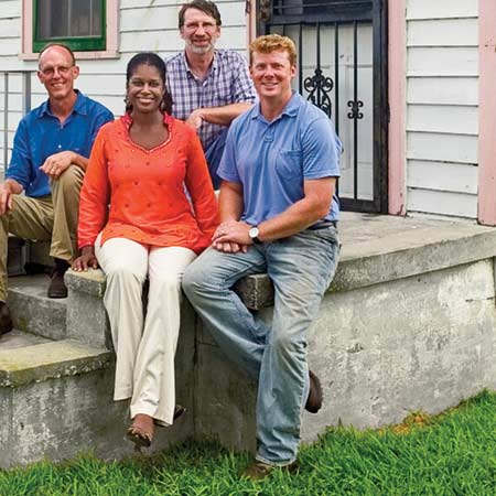 group shot of kevin, norm, and new orleans project home owner