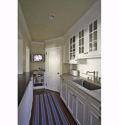 small kitchen with crown molding and flatscreen television