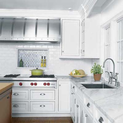 white kitchen with marble counters and steel accents