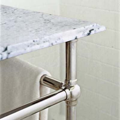 marble top sink on a three legged stand