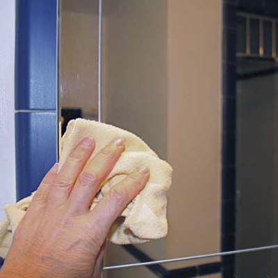 car wax can help prevent condensation on a bathroom mirror