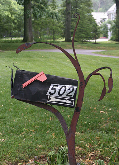 Sculpture mailbox post