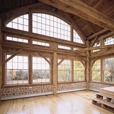 granary-turned-sunroom in a log barn adapted to be a home