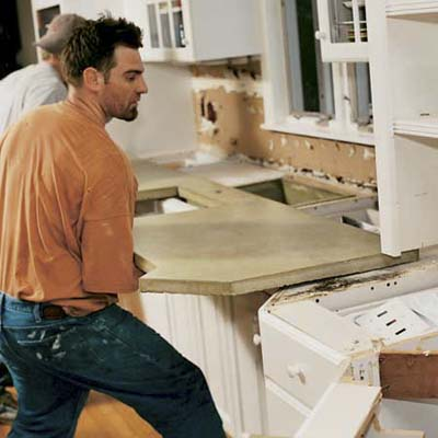 men carrying concrete countertop