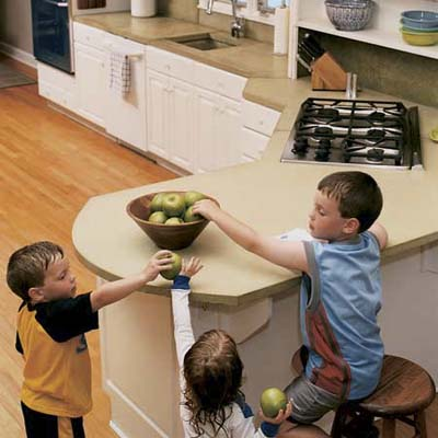 kids reaching for apples on a finished countertop