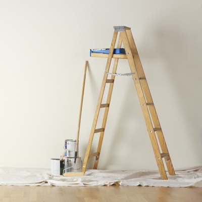 ladder, paint trays, rollers, paint cans, dropcloth