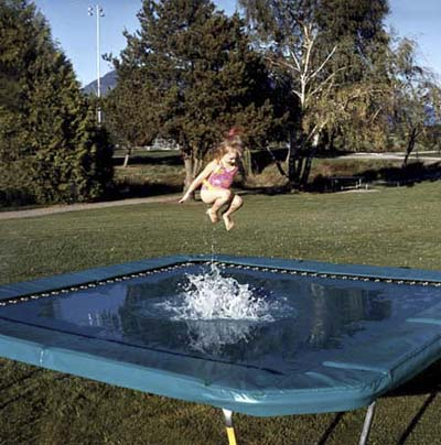 an outdoor trampoline that can be used with or without a layer of water