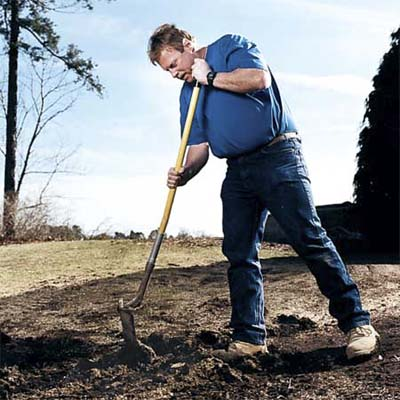 do flip a round-point shovel around, orientating the back of the shovel head parallel to the hole