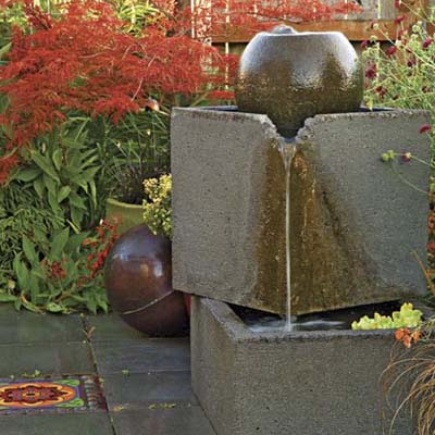 plug-in concrete fountain and bright mosaic accent pavers