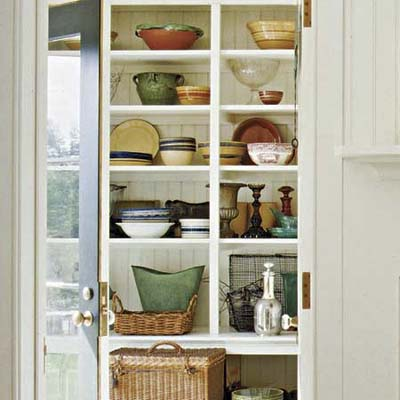 A vestibule with open shelves used for storage.