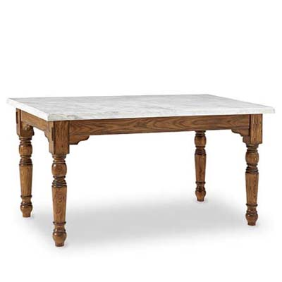 A long rectangular farmhouse table with carrara marble slab top.