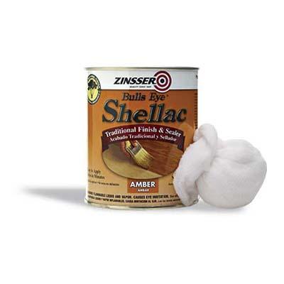 Can of Bulls Eye shellac with rag