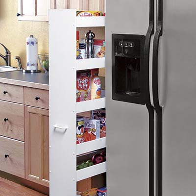 smart kitchen pantry storage upgrade to keep your life organized: thin pantry caddy fits in the space between fridge and cabinetry