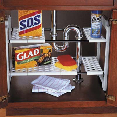 smart kitchen and linen storage upgrades to keep your life organized: undersink storage shelves